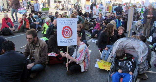 Climate March people in road said down